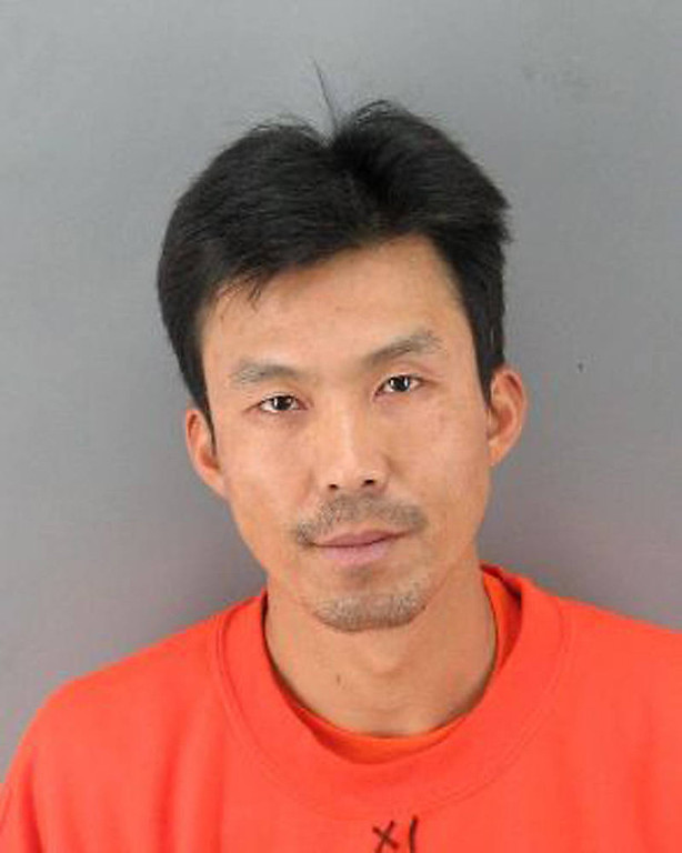 . In this file booking photo taken Sunday March 25, 2012 and provided by the San Francisco Police Dept. is Binh Thai Luc, 35, of Vietnam, who was arrested and is being held on suspicion of five counts of murder. The case of the man accused of brutally killing five people in a San Francisco home has shed harsh light on a law that has allowed thousands of immigrants who have served time for crimes to be released in this country because their countries would not take them back. (AP Photo/San Francisco Police Dept.,File)