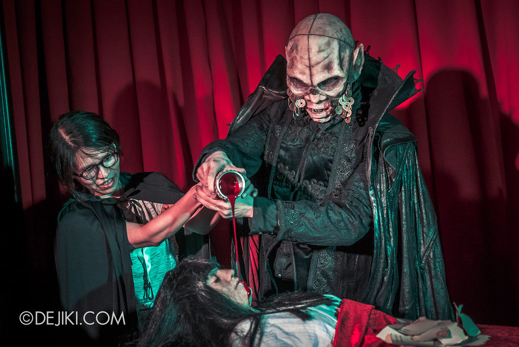 Halloween Horror Nights 8 Press Conference - Killuminati Haunted House - Pouring blood from chalice onto the sacrifice