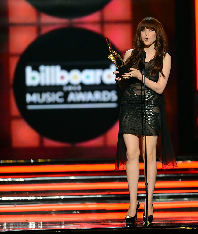 ". Singer Carly Rae Jepsen accepts the award for ""Top Digital Song\"" onstage during the 2013 Billboard Music Awards at the MGM Grand Garden Arena on May 19, 2013 in Las Vegas, Nevada.  (Photo by Ethan Miller/Getty Images)"