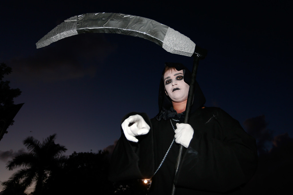 . A fan poses for a photograph on Halloween prior to the game between the Miami Dolphins and the Cincinnati Bengals at Sun Life Stadium on October 31, 2013 in Miami Gardens, Florida. (Photo by Chris Trotman/Getty Images)