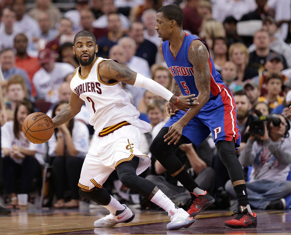 . Cleveland Cavaliers\' Kyrie Irving (2) drives against Detroit Pistons\' Kentavious Caldwell-Pope (5) during the first half in Game 2 of a first-round NBA basketball playoff series, Wednesday, April 20, 2016, in Cleveland. The Cavaliers won 107-90. (AP Photo/Tony Dejak)