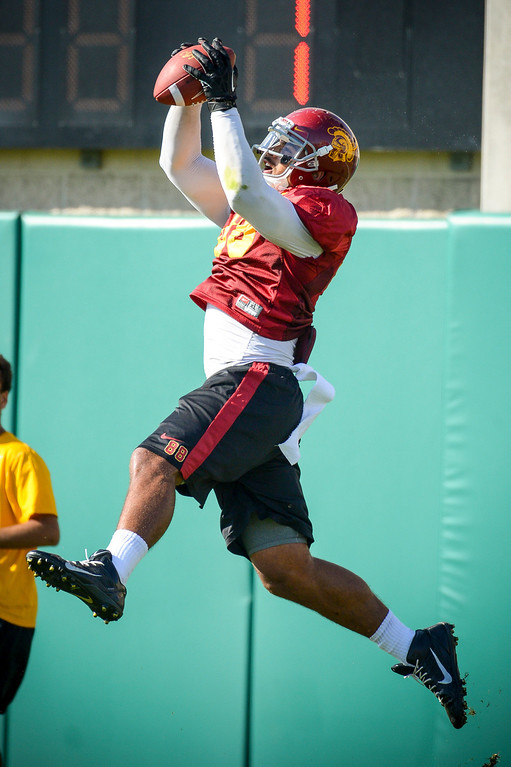 . USC�s Jalen Cope-Fitzpatrick pulls a pass during spring practice at USC Tuesday, April 15, 2014.  (Photo by David Crane/Los Angeles Daily News.)