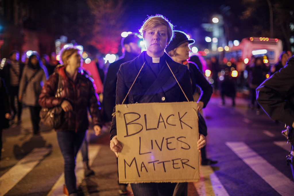 . Demonstrators march during a protest November 25, 2015 in New York City, one day after a grand jury decision not to prosecute a white police officer for the killing of an unarmed black teen in Ferguson, Missouri.    AFP PHOTO / Kena BETANCUR/AFP/Getty Images