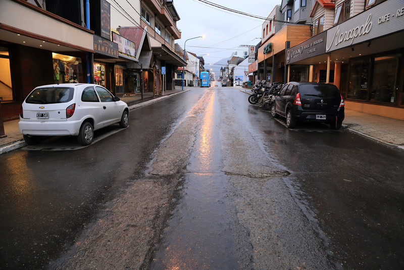 Av San Martín, Ushuaia, center of he road is heavily worn down by winter tire chains or  tire studs perhaps...