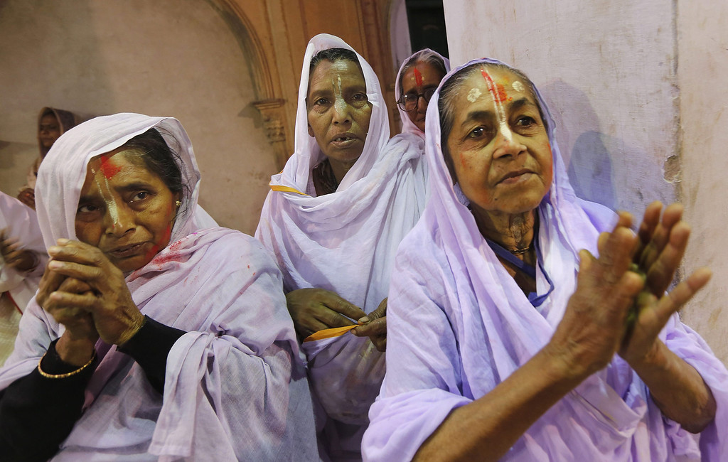 . Indian widows attend a prayer as they participate in the Holi festival in Vrindavan, Uttar Pradesh, India, March 14, 2014.  EPA/HARISH TYAGI