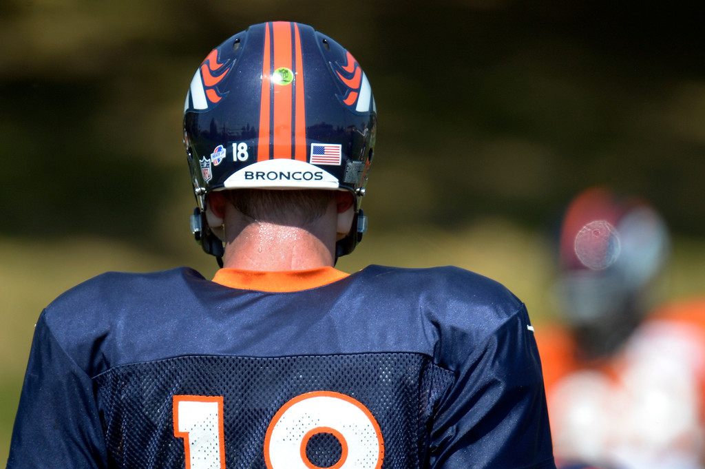 . Denver Broncos quarterback Peyton Manning (18) during drills at practice August 20, 2013 at Dove Valley (Photo by John Leyba/The Denver Post)