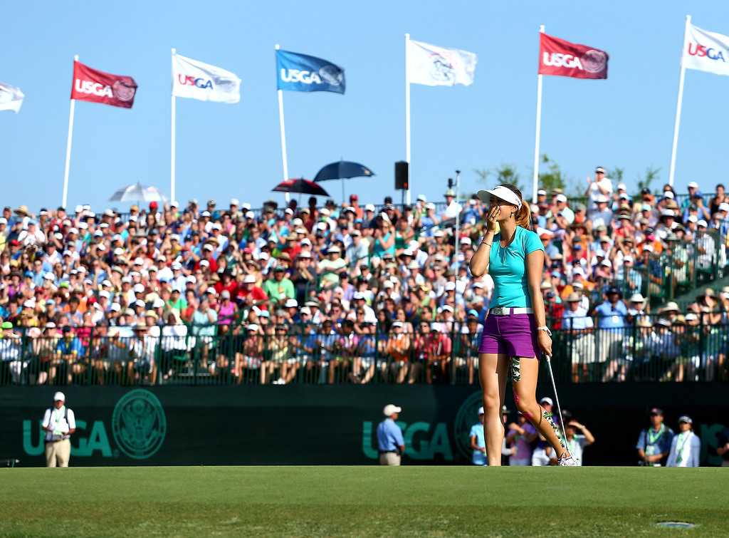 . Michelle Wie of the United States celebrates her two shot victory during the final round of the 69th U.S. Women\'s Open at Pinehurst Resort & Country Club, Course No. 2 on June 22, 2014 in Pinehurst, North Carolina.  (Photo by Streeter Lecka/Getty Images)