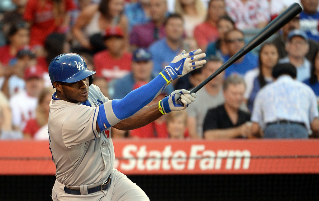 . Los Angeles Dodgers\' Yasiel Puig watches his single in the first inning of a baseball game against the Los Angeles Angels at Anaheim Stadium in Anaheim, Calif., on Thursday, Aug. 7, 2014.  (Photo by Keith Birmingham/ Pasadena Star-News)