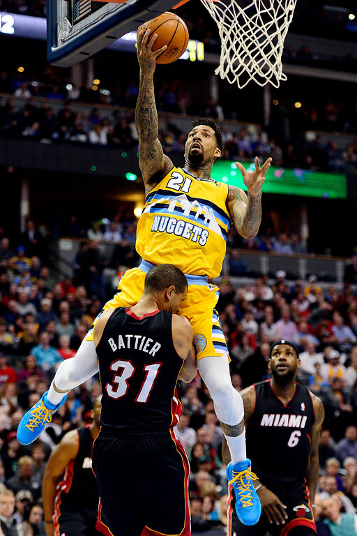 . Wilson Chandler (21) of the Denver Nuggets scores over Shane Battier (31) of the Miami Heat during the first half of action.   (Photo by AAron Ontiveroz/The Denver Post)