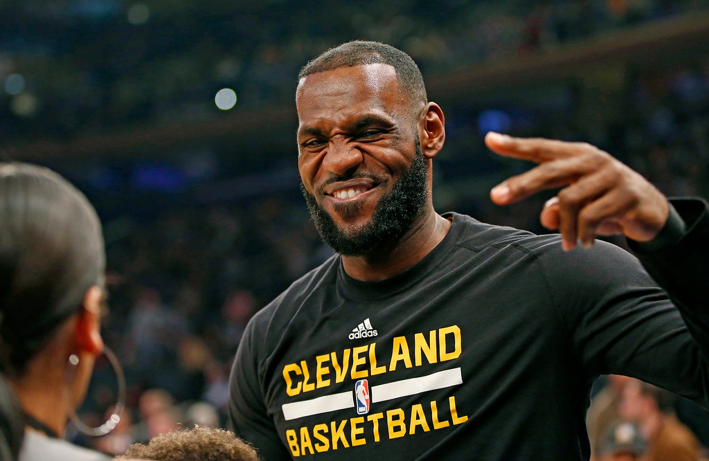 . Cleveland Cavaliers forward LeBron James reacts as he sees a friend on the sideline before the start of the first quarter of an NBA basketball game against the New York Knicks at Madison Square Garden in New York, Wednesday, Dec. 7, 2016. (AP Photo/Kathy Willens)