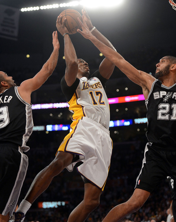 . The Lakers\'  Dwight Howard #12 shoots and Spurs\' Tony Parker #9 and Tim Duncan #21 defend during game four of their NBA Western Conference playoffs at the Staples Center Saturday, April 28, 2013. The Spurs beat the Lakers 120-89. (Hans Gutknecht/Staff Photographer)