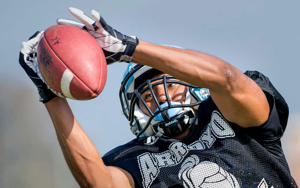 . Arroyo High WR hauls in a pass during preseason practice at the El Monte campus August 14, 2013.   (SGVN/Staff photo by Leo Jarzomb)
