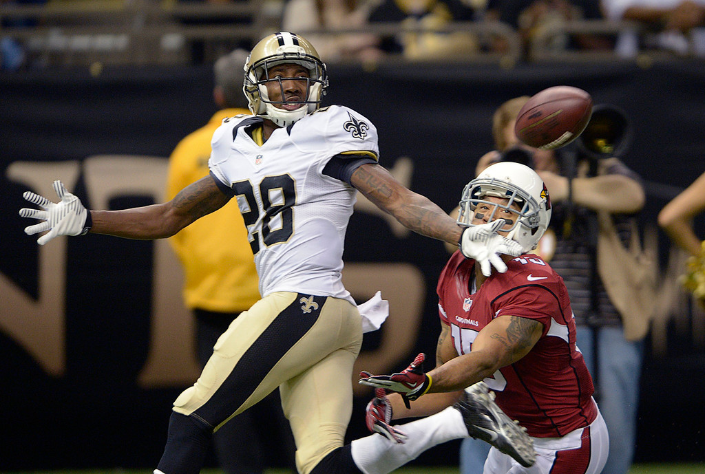 . New Orleans Saints cornerback Keenan Lewis (28) breaks up a pass intended for Arizona Cardinals wide receiver Michael Floyd (15) in the first half of an NFL football game in New Orleans, Sunday, Sept. 22, 2013. (AP Photo/Bill Feig)