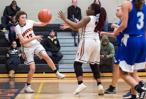 01/31/20 Wesley Bunnell | StaffrrE.C. Goodwin girls basketball defeated Grasso Tech on Friday January 31, 2020 at home. Ericka Aponte (13) saves a ball from going out of bounds.
