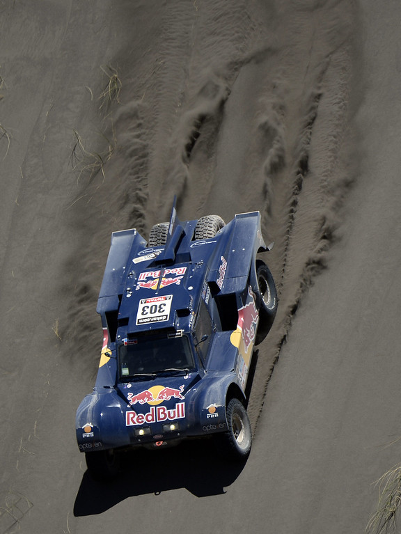 . SMG driver Spain\'s Carlos Sainz and co-driver Germany\'s Timo Gottschalk compete during the 2014 Dakar Rally Stage 2 between San Luis and San Rafael, Argentina, on January 6, 2014.     FRANCK FIFE/AFP/Getty Images