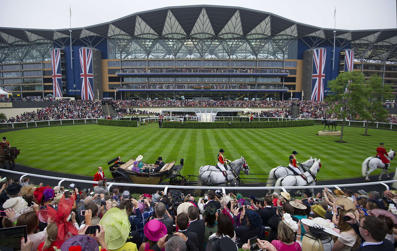 . Britain\'s Queen Elizabeth II arrives on the third day of Royal Ascot, in Berkshire, west of London, on June 20, 2013. The five-day meeting is one of the highlights of the horse racing calendar. Horse racing has been held at the famous Berkshire course since 1711 and tradition is a hallmark of the meeting. Top hats and tails remain compulsory in parts of the course while a daily procession of horse-drawn carriages brings the Queen to the course.  CARL COURT/AFP/Getty Images