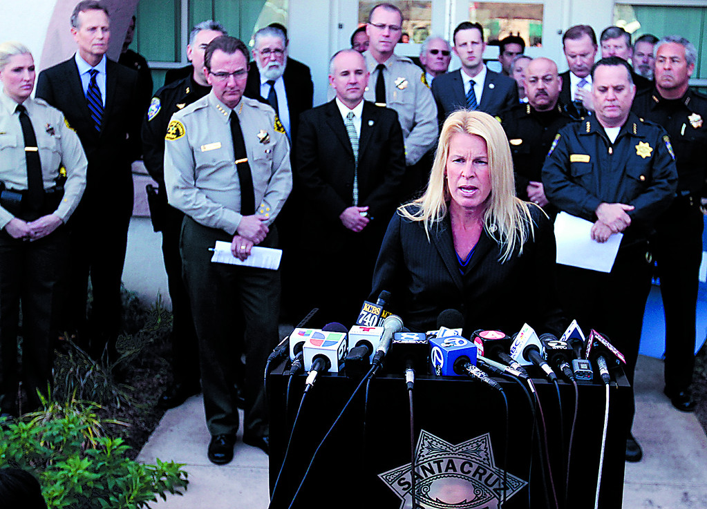 . Santa Cruz Mayor Hilary Bryant speaks at Wednesday\'s news conference at Santa Cruz Police Headquarters about the murder of SCPD detectives Elizabeth Butler and Loran \'Butch\' Baker. (Shmuel Thaler/Sentinel)