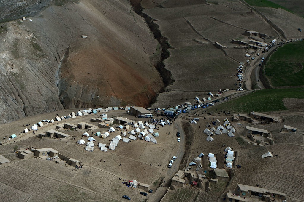 . Afghan landslide-affected villagers gather near tents during aid distribution in Aab Bareek village at Argo district of Badakhshan on May 5, 2014.   AFP PHOTO/WAKIL  KOHSAR/AFP/Getty Images