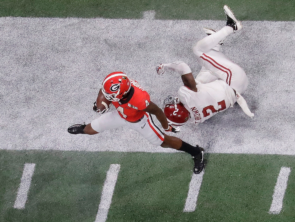 . Georgia wide receiver Mecole Hardman gets past Alabama defensive back Tony Brown for a touchdown catch during the second half of the NCAA college football playoff championship game Monday, Jan. 8, 2018, in Atlanta. (AP Photo/John Bazemore)
