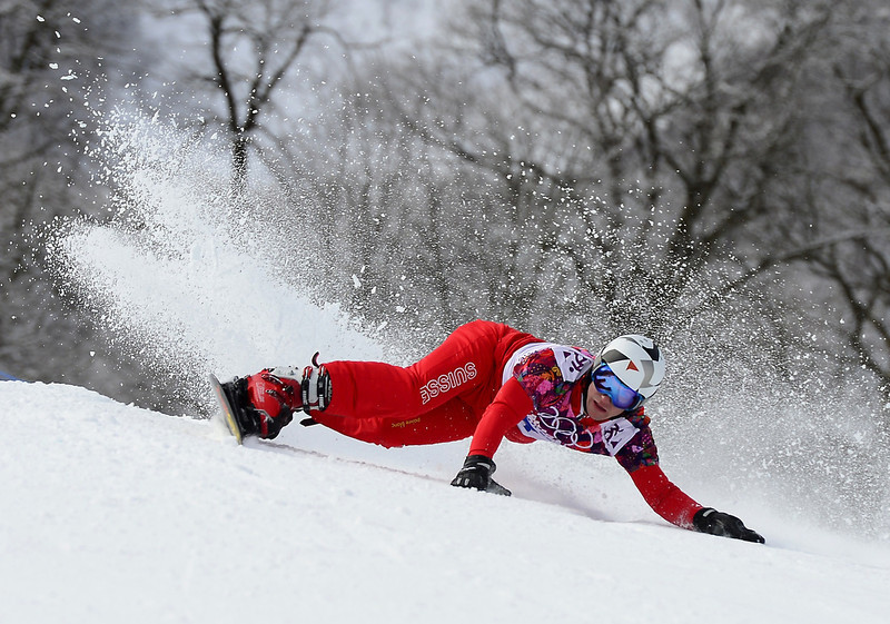 . Switzerland\'s Nevin Galmarini competes in the Men\'s Snowboard Parallel Giant Slalom elimination run at the Rosa Khutor Extreme Park during the Sochi Winter Olympics on February 19, 2014.  JAVIER SORIANO/AFP/Getty Images