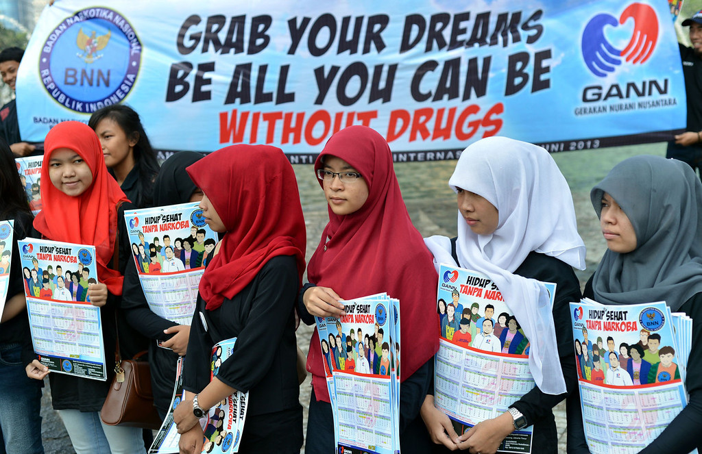 """. Indonesian women hold placards reading \""""healthy life without drugs\"""" during an anti-drugs campaign in Jakarta on June 26, 2013. The campaign was staged to mark the UN\'s international day against drug abuse and illicit trafficking.  BAY ISMOYO/AFP/Getty Images"""