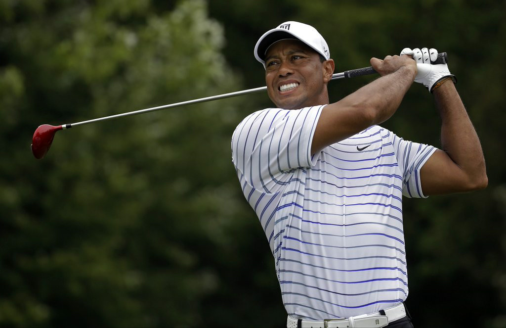 ". <p><b> Tiger Woods, laid low by several disappointing years, revealed that he has finally given up any hope of � </b> </p><p> A. Playing in the 2014 Ryder Cup </p><p> B. Surpassing Jack Nicklaus� record of 18 Grand Slam titles </p><p> C. Weening himself off strippers and porn stars </p><p><b><a href=""http://online.wsj.com/articles/without-tiger-woods-u-s-might-have-a-chance-at-ryder-cup-1408148453\"" target=\""_blank\"">LINK</a></b> </p><p>   (AP Photo/Jeff Roberson)</p>"