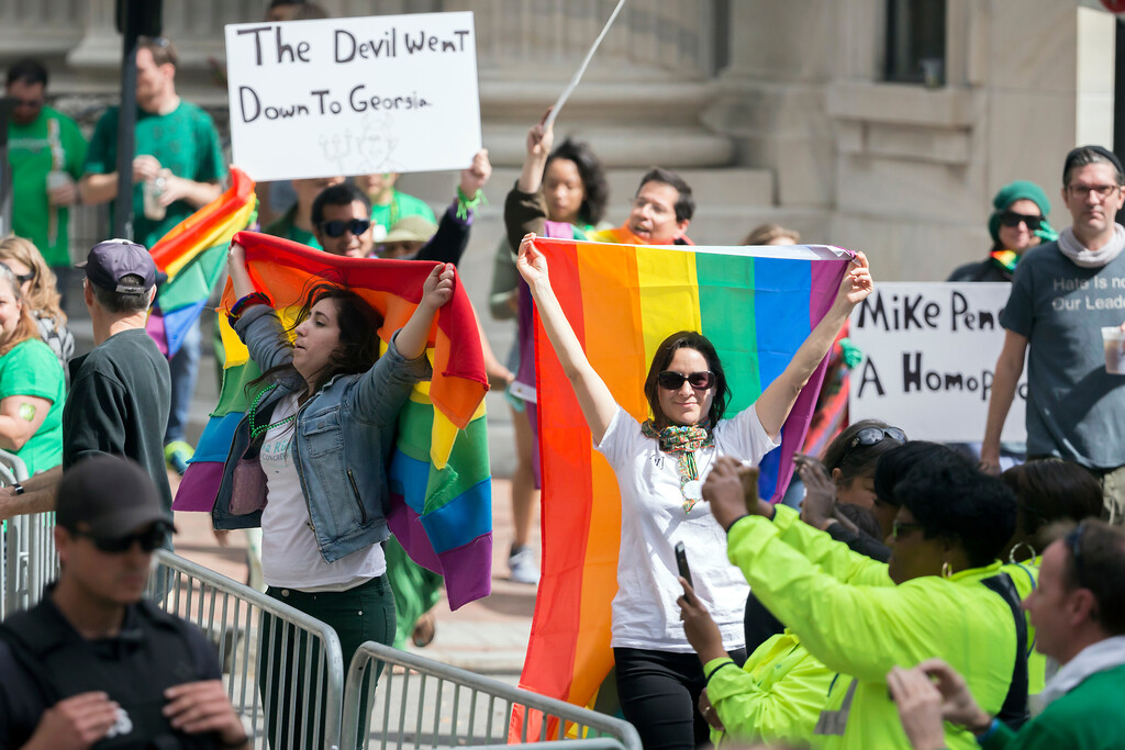 . A group of LBGTQ protesters jeer Vice President Mike Pence as he walks the Savannah St. Patrick\'s Day parade, Saturday, March 17, 2018, in Savannah, Ga. (AP Photo/Stephen B. Morton)
