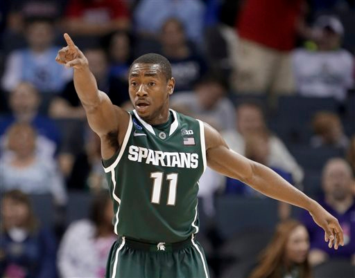 . Michigan State\'s Lourawls Nairn Jr. reacts during the first half of an NCAA tournament college basketball game against Virginia in the Round of 32 in Charlotte, N.C., Saturday, March 21, 2015. (AP Photo/Gerald Herbert)