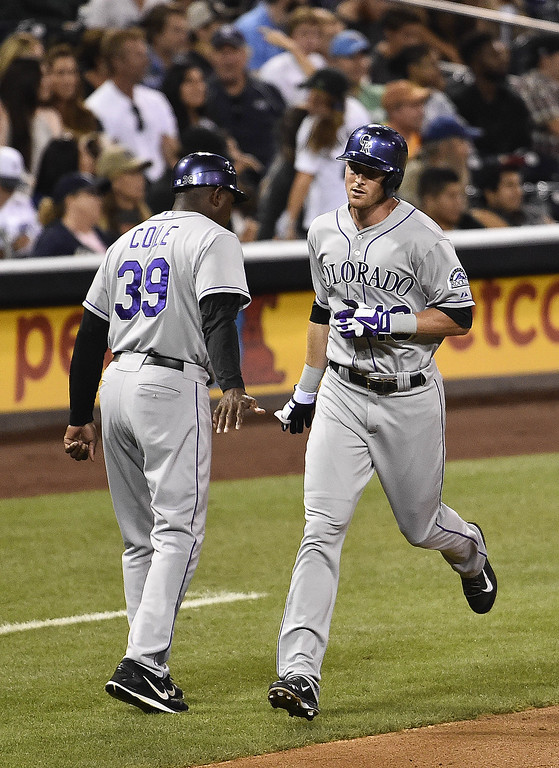 . SAN DIEGO, CA - SEPTEMBER 23:  Drew Stubbs #13 of the Colorado Rockies, right, is congratulated by Stu Cole #39 after he hit a solo home run during the eighth inning of a baseball game against the San Diego Padres at Petco Park September, 23, 2014 in San Diego, California.  (Photo by Denis Poroy/Getty Images)