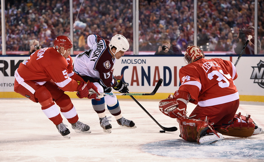 . DENVER, CO - FEBRUARY 26: Colorado Avalanche Valeri Kaminsky (13) takes a shot on Detroit Red Wings G Manny Legace (34) as Nicklas Lidstrom (5) defends on the play February 26, 2016 at Coors Field. (Photo By John Leyba/The Denver Post)
