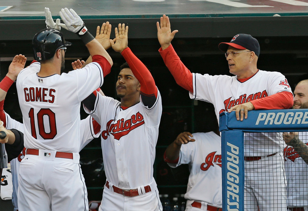 . Cleveland Indians\' Yan Gomes (10) is congratulated by teammates after hitting a solo home run off Kansas City Royals starting pitcher Edinson Volquez in the second inning of a baseball game, Friday, June 3, 2016, in Cleveland. (AP Photo/Tony Dejak)