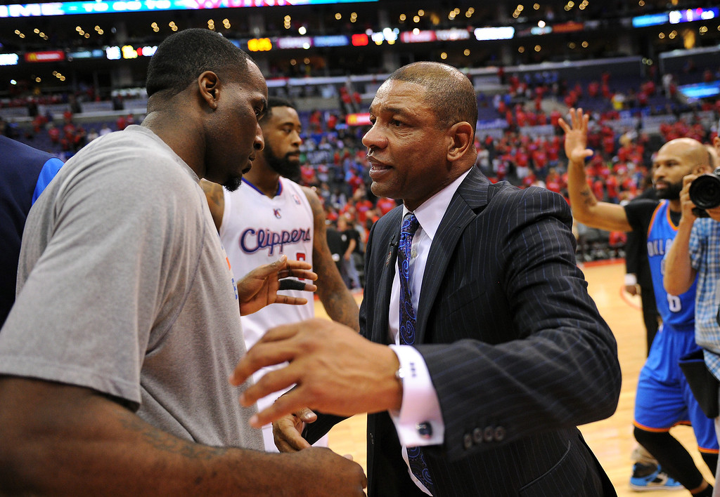 . Clippers coach Doc Rivers congratulates the Thunder\'s Kendrick Perkins after the Thunder won the series 104-98, Thursday, May 15, 2014, at Staples Center. (Photo by Michael Owen Baker/Los Angeles Daily News)
