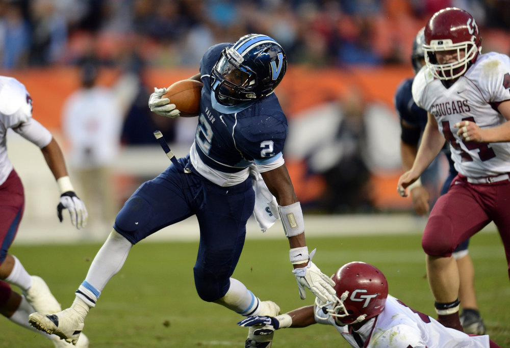 . Valor Christian RB Daryl Hawkins rushes against the Cherokee Trail defense during the 1st half of the 5A State Championship game at Sports Authority Field at Mile High on Saturday in Denver, CO on December 1, 2012. Hyoung Chang, The Denver Post
