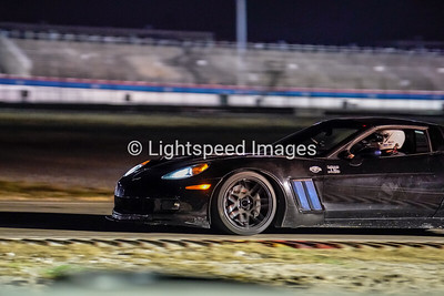 A. Jones - Black C6 Z06 Corvette