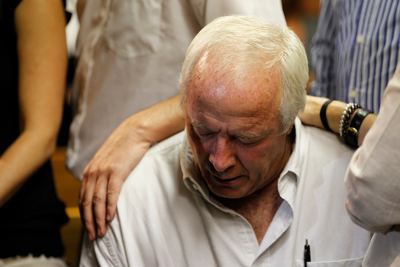 . Oscar Pistorius\'s father Henke reacts as he awaits the start of court proceedings in the Pretoria Magistrates court, February 19, 2013. Pistorius, a double amputee who became one of the biggest names in world athletics, was applying for bail aftr being charged in court with shooting dead his girlfriend, 30-year-old model Reeva Steenkamp, in his Pretoria house. REUTERS/Siphiwe Sibeko