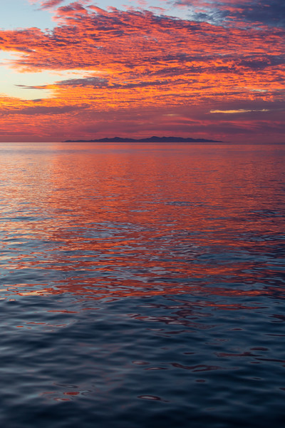 Burning orange colors reflect off the waves of the sea of Cortez in Mexico - , , , Mexico (MX)