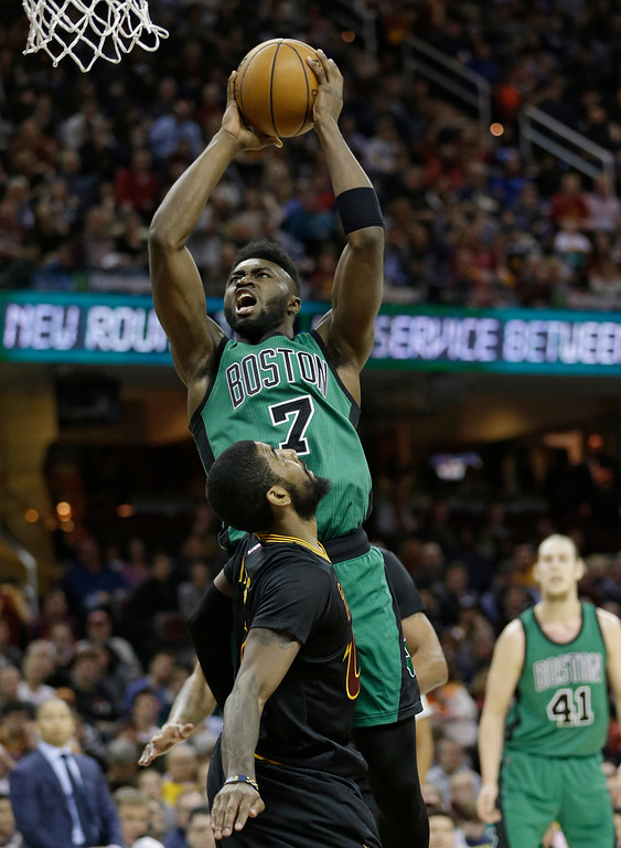 . Boston Celtics\' Jaylen Brown (7) shoots over Cleveland Cavaliers\' Kyrie Irving (2) in the first half of an NBA basketball game, Thursday, Dec. 29, 2016, in Cleveland. (AP Photo/Tony Dejak)