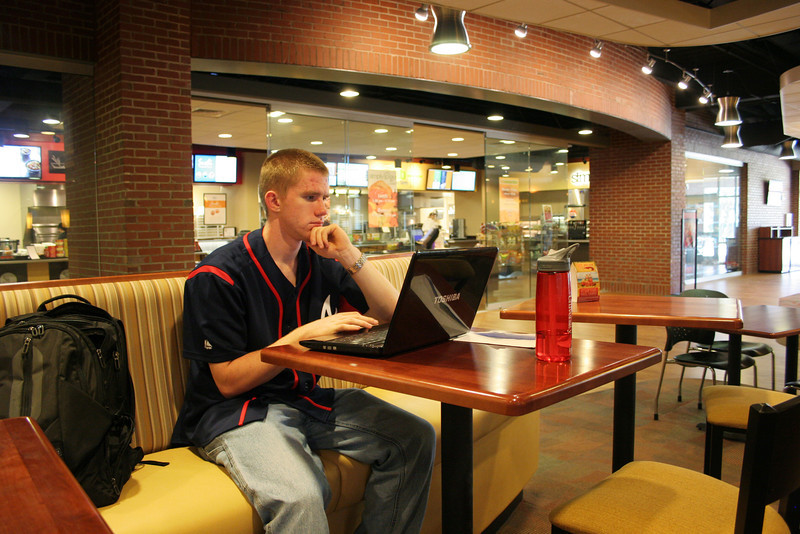 A Gardner-Webb student studies as he sits in the downstairs area of the Tucker Student Center.