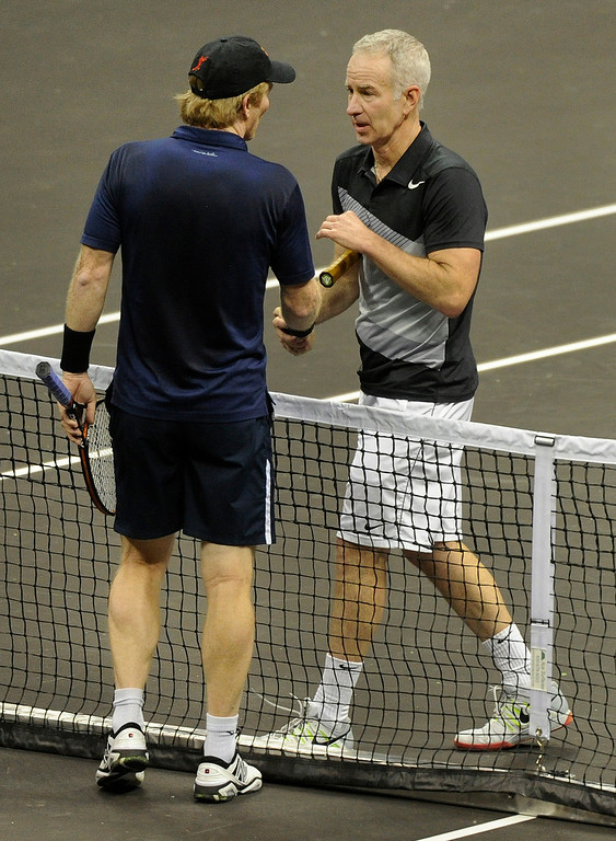 . John McEnroe shook hands with opponent Jim Courier in a match won by McEnroe 6-4 Thursday night. McEnroe faced Jim Courier in an exhibition match at the Pepsi Center Thursday night, November 29, 2012. McEnroe is ranked second behind Courier in the 2012 PowerShares Series tour. Karl Gehring/ The Denver Post
