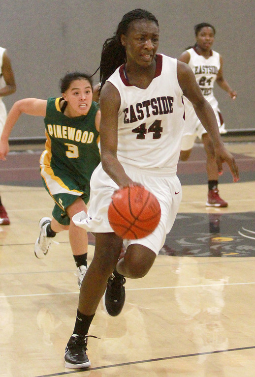. Eastside Prep\'s Hashima Carothers drives the ball to the hoop off a turnover followed by  Pinewood\'s Marissa Hing during a game in the third quarter at Eastside Prep High School on Tuesday, Feb. 5, 2013.     (Kirstina Sangsahachart/ Daily News)