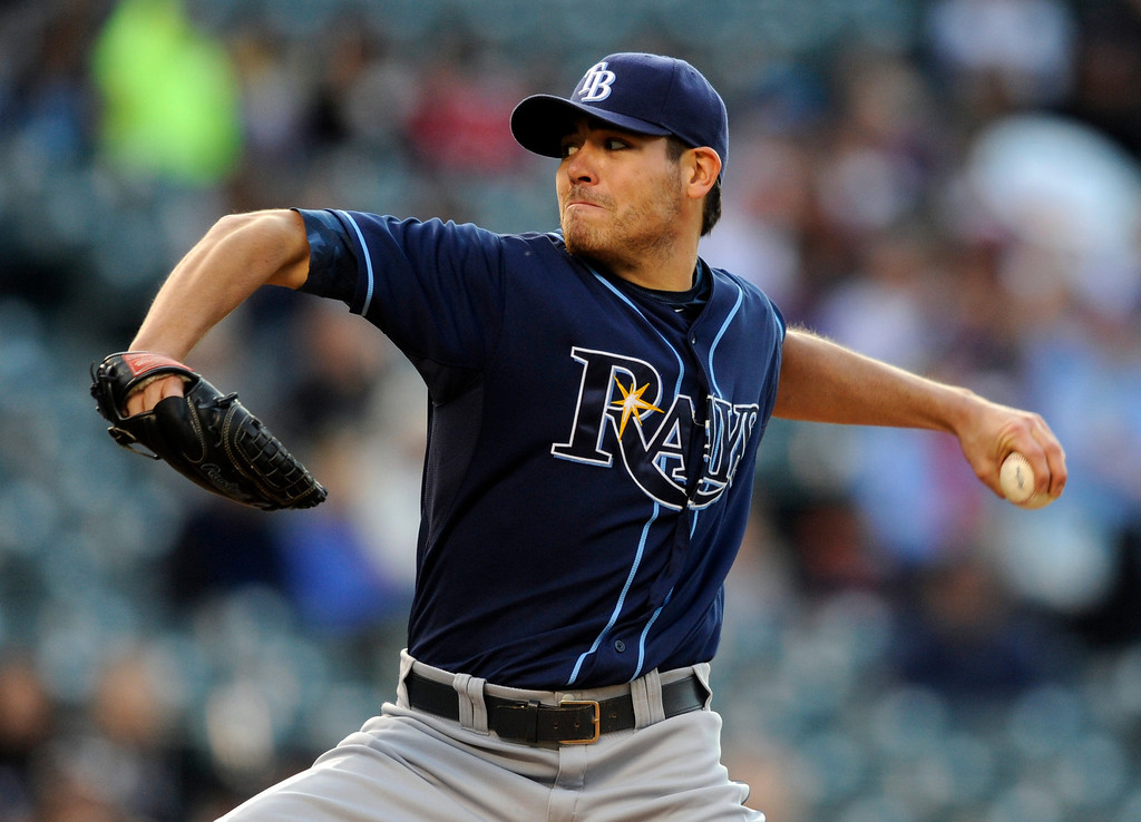 . Tampa Bay Rays starting pitcher Matt Moore throws to the plate against the Colorado Rockies during the first inning of a baseball game on Friday, May 3, 2013, in Denver. (AP Photo/Jack Dempsey)