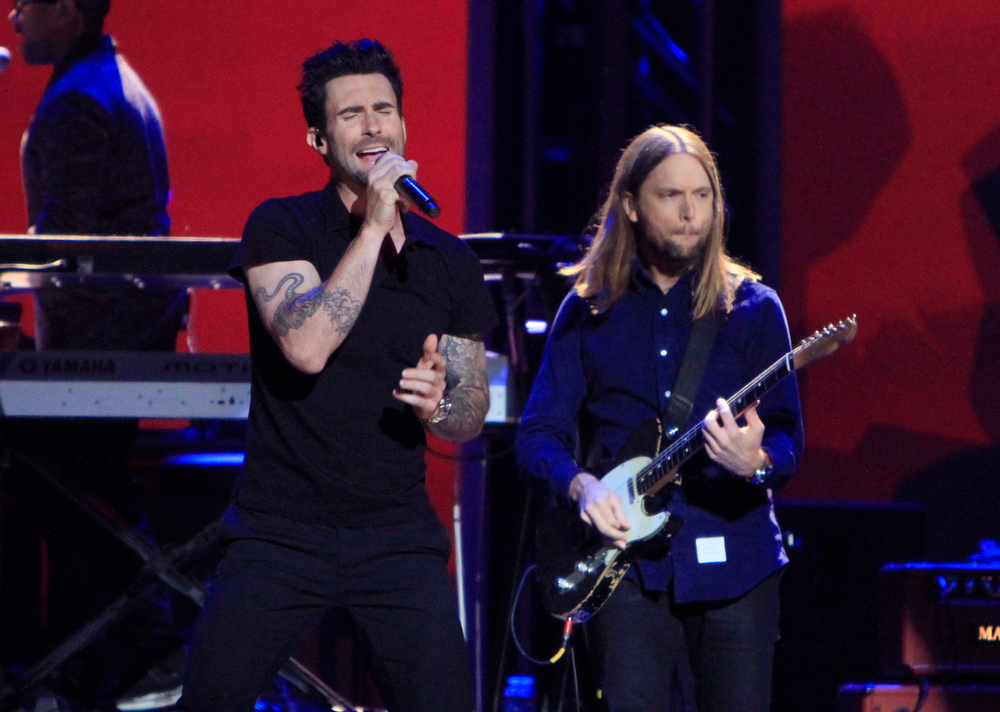 Description of . Adam Levine, left, and James Valentine, of the musical group Maroon 5, perform at the Grammy Nominations Concert Live! at Bridgestone Arena on Wednesday, Dec. 5, 2012, in Nashville, Tenn. (Photo by Wade Payne/Invision/AP)