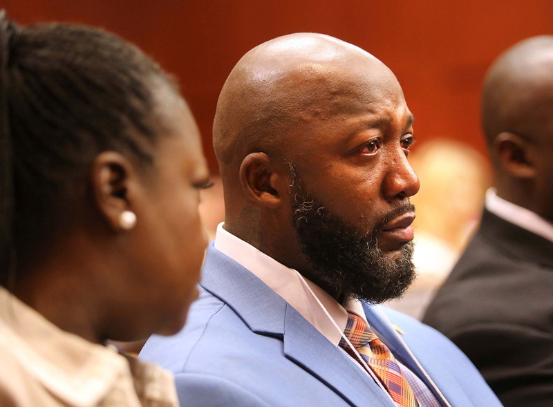 . The father of  Trayvon Martin, Tracy Martin, cries as he listens to the description of his son\'s death, as Sybrina Fulton (L), Trayvon\'s mother, looks on during the opening day of the George Zimmerman trial in Seminole circuit court in Sanford, Florida, June 24, 2013. Zimmerman is accused in the fatal shooting of Trayvon Martin.     REUTERS/Joe Burbank/Pool