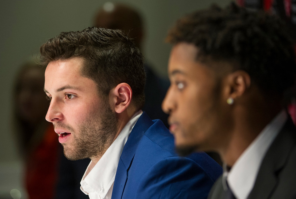 . Cleveland Browns first-round draftee Baker Mayfield, left, answers a question as Denzel Ward listens during an NFL football news conference at the team\'s headquarters in Berea, Ohio, Friday, April 27, 2018. (AP Photo/Phil Long)