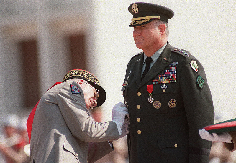 . US General Norman Schwarzkopf (R) shown in a photo dated 24 July 1991 being decorated with the medal of Grand Officer of the Legion of Honor, the highest distinction awarded to a foreign policy figure by General Maurice Schmitt, who headed the French contingent to the allied operation against Iraq, at a ceremony at the Aubagne base, the French Foreign Legion base, in Southern France. (ERIC CABANIS/AFP/Getty Images)