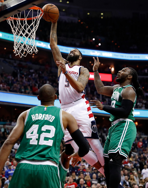 . Washington Wizards forward Markieff Morris (5) can\'t dunk the ball in front of Boston Celtics forward Jae Crowder (99) and center Al Horford (42) during the first half of Game 6 of the Eastern Conference semifinal NBA basketball playoff series, Friday, May 12, 2017, in Washington. (AP Photo/Alex Brandon)