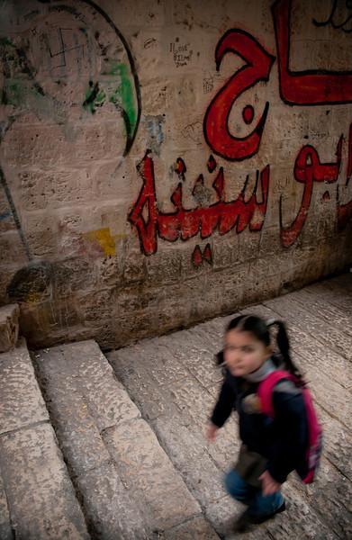 Muslim girl walks to school in the Arab Quarter.  Jerusalem, Israel, 2012.