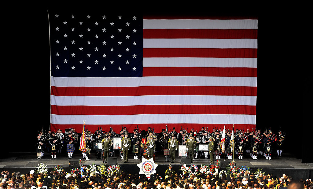 . An American flag hangs above the stage during memorial services for San Bernardino County Sheriff Deputy Jeremiah MacKay at the San Manuel Amphitheater in Devore February 21, 2013.  GABRIEL LUIS ACOSTA/STAFF PHOTOGRAPHER.