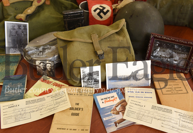Harold Aughton/Butler Eagle: The artifacts, Elmer Glenn, 95, brought back from Europe, serve as a harsh reminder of the challenges he faced. Glenn served with the U.S. Arm, 4th infantry division, during WWII.