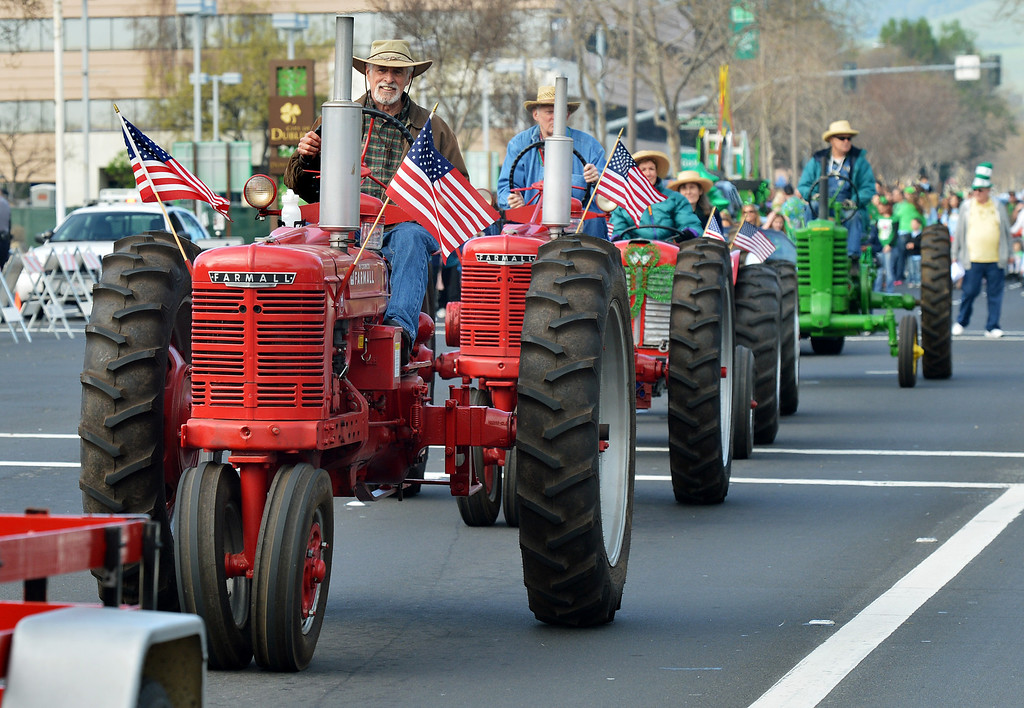 . Tony Hurt, of Dublin, drives a tractor down Dublin Boulevard during the Saint Patrick\'s Day Parade in Dublin, Calif., on Saturday, March 16, 2013. (Dan Rosenstrauch/Staff)